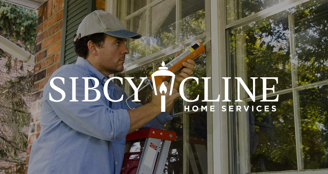 Handyman caulking windows.